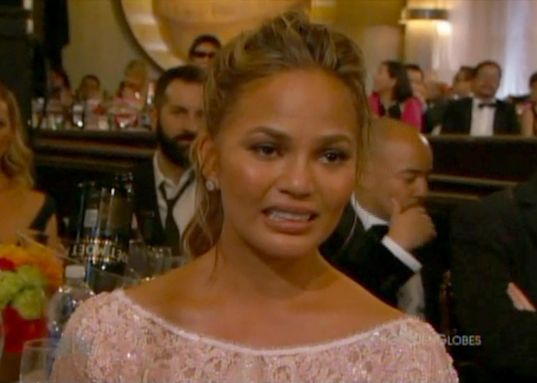 Chrissy Teigen reacting at Golden Globes 2015