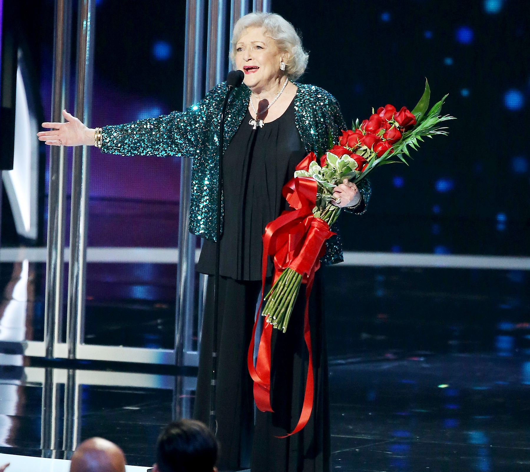 "At age 93, a shocked and overjoyed White was led to the stage by a hunky Chris Evans at the 2015 People's Choice Awards to accept the Favorite TV Icon Award. ""Oh my goodness!"" she exclaimed."