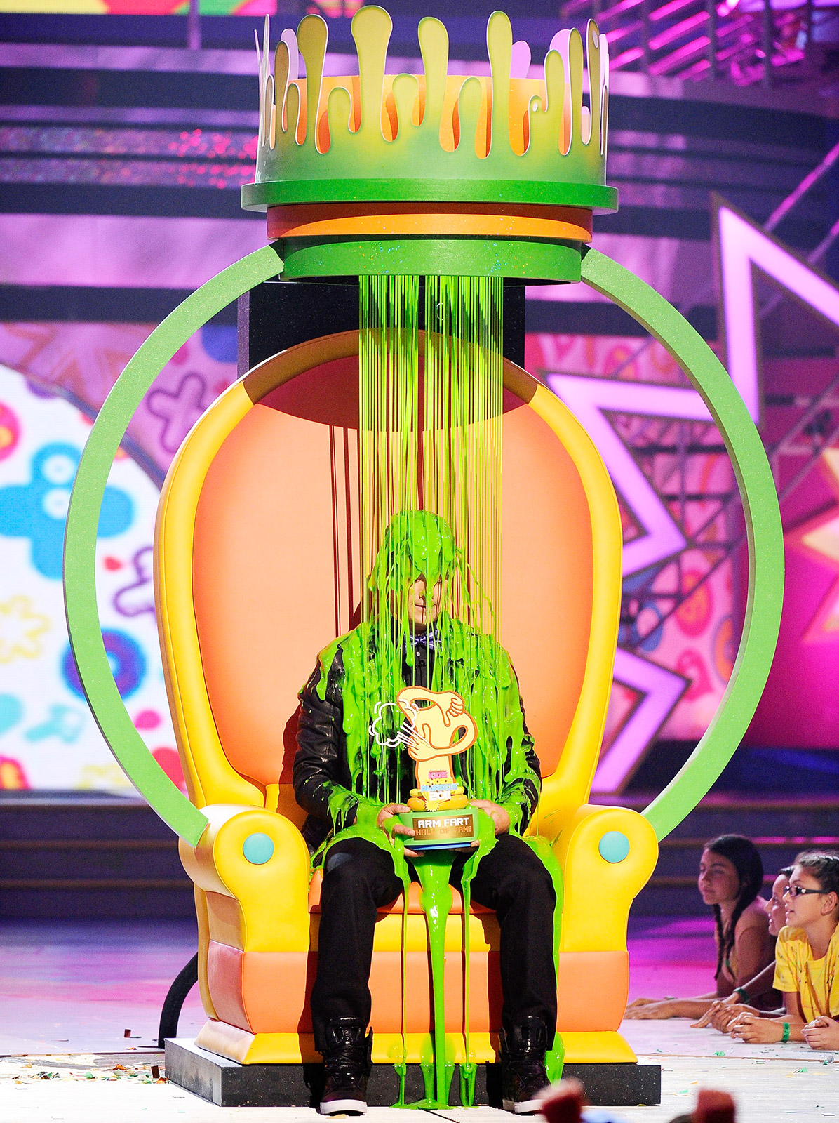 "Two years before he was asked to host the show, the When in Rome actor was showered in slime after being named the ""Arm Fart Champion"" by viewers. ""That's right!"""