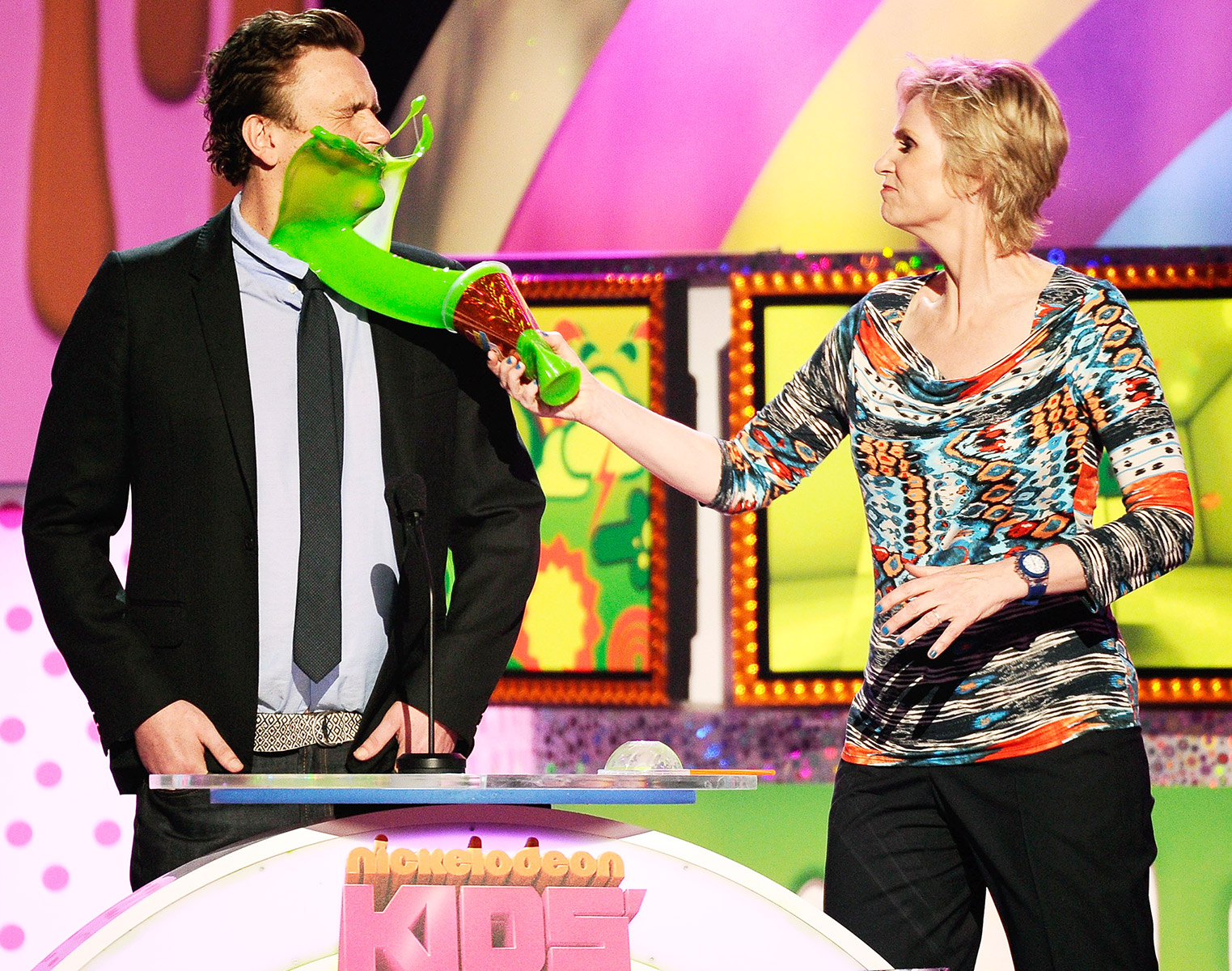 On April 2, 2011, the How I Met Your Mother actor was slimed by his co-presenter Jane Lynch , who payed homage to a scene from her hit FOX series Glee .