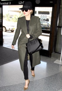 Khloe Kardashian goes incognito at LAX on April 27, 2015.