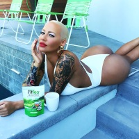 Amber Rose shows off her butt in a white swimsuit on Instagram.