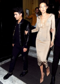 Joe Jonas and Gigi Hadid leave the Balmain dinner on Oct. 1, 2015.