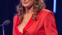 Caitlyn Jenner stunned in a low-cut red pantsuit