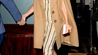 Kate Hudson wears a camel coat in Soho on October 19, 2015 in NYC.
