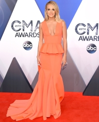 Carrie Underwood Stuns in Coral Peplum Dress on the CMA Red Carpet