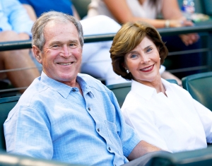 George W. Bush and Laura Bush during the game between the Seattle Mariners and the Texas Rangers at Globe Life Park in Arlington on September 19, 2015 in Arlington, Texas.