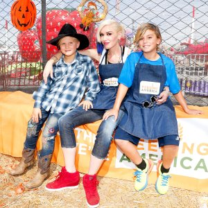 Gwen Stefani Zuma and Kingston at the Feeding America Holiday Harvest event at Shawn's Pumpkin Patch on October 24, 2015 in Culver City, California.