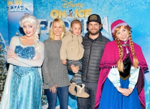 "Jack Osbourne and wife Lisa with their daughter Pearl attend the premiere of Disney On Ice's ""Frozen"" at Staples Center on December 10, 2015 in Los Angeles, California."