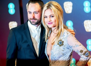 Julia Stiles and Preston J. Cook attend the 70th British Academy Film Awards at the Royal Albert Hall on February 12, 2017 in London, England.