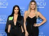 Kim Kardashian West (L) and Khloe Kardashian