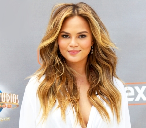 "Chrissy Teigen visits ""Extra"" at Universal Studios Hollywood in Universal City, California."