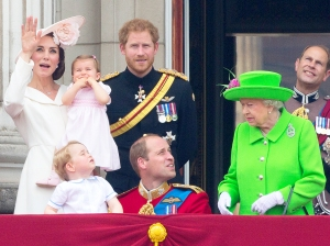 Catherine, Duchess of Cambridge holding her daughter Princess Charlotte, Prince George, Britain's Prince William, Duke of Cambridge, Britain's Prince Harry and Britain's Queen Elizabeth II stand on the balcony of Buckingham Palace to watch a fly-past of aircrafts by the Royal Air Force, in London on June 11, 2016.