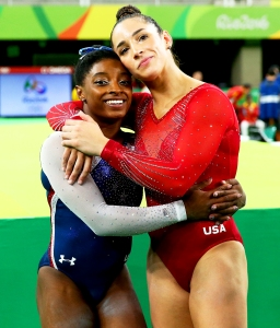 Simone Biles and Aly Raisman of the United States during the Women's Individual All Around Final on Day 6 of the 2016 Rio Olympics at Rio Olympic Arena in Rio de Janeiro, Brazil.