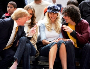 Donald Trump, Melania Trump, Beth Ostrosky and Howard Stern attend the Washington Wizards vs. New York Knicks Game on November 4, 2005 in New York City.