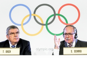 International Olympic Committee (IOC) President Thomas Bach and Chairman of IOC Inquiry Commission into alleged Russian doping at Sochi 2014 Swiss Samuel Schmid attends a press conference following an executive meeting on Russian doping, on December 5, 2017 in Lausanne.