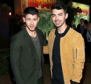 "Nick Jonas and Joe Jonas attend the premiere of Columbia Pictures' ""Jumanji: Welcome To The Jungle"" on December 11, 2017 in Hollywood, California."