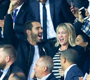 Clement Giraudet and Robin Wright attends the UEFA Champions League group B match at Parc des Princes on September 27, 2017 in Paris, France.