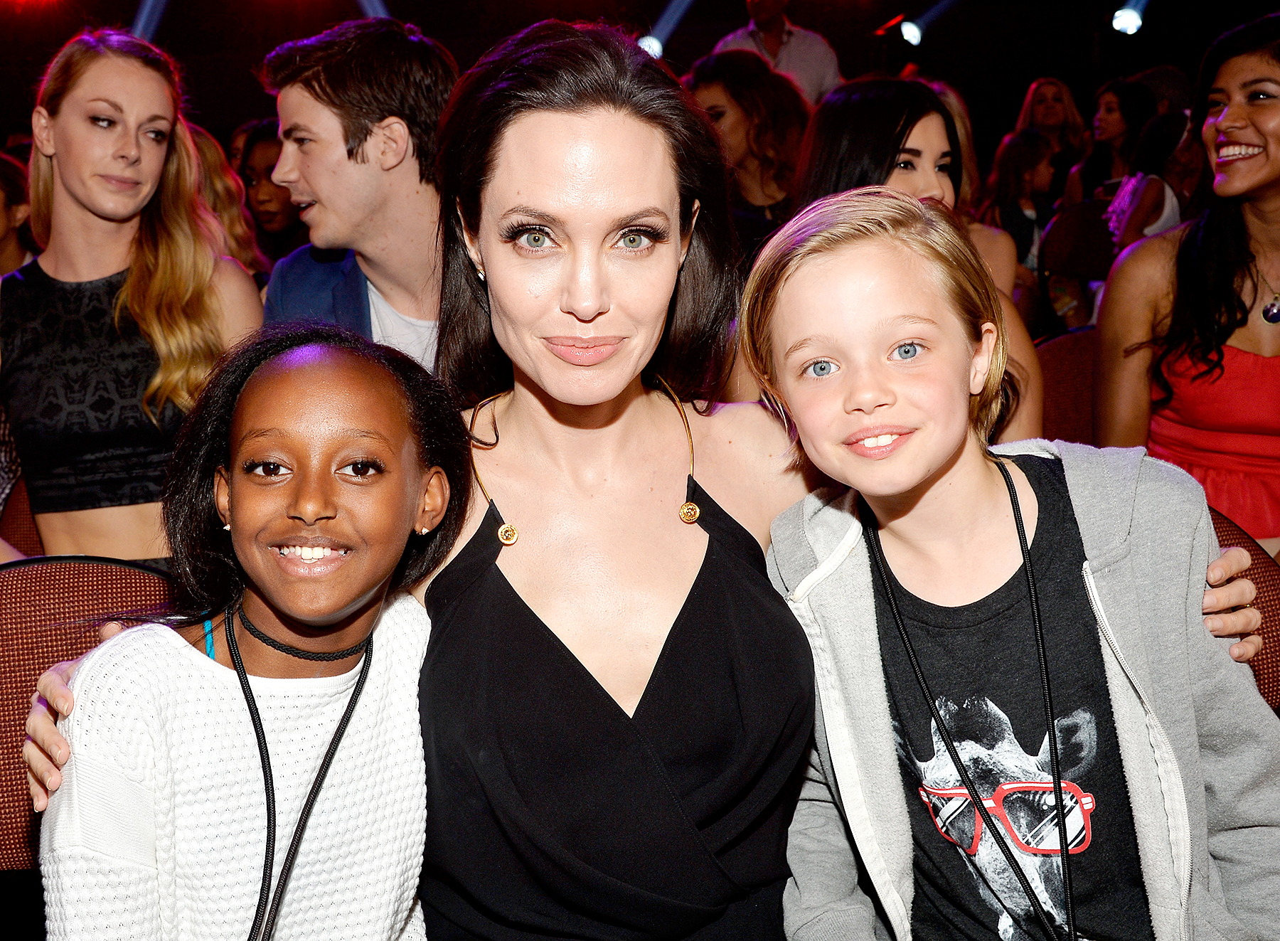 angelina-jolie-shiloh-jolie-pitt-broken-collarbone - Angelina Jolie (C) with Zahara Marley Jolie-Pitt (L) and Shiloh Nouvel Jolie-Pitt (R) in the audience during Nickelodeon's 28th Annual Kids' Choice Awards held at The Forum on March 28, 2015 in Inglewood, California.