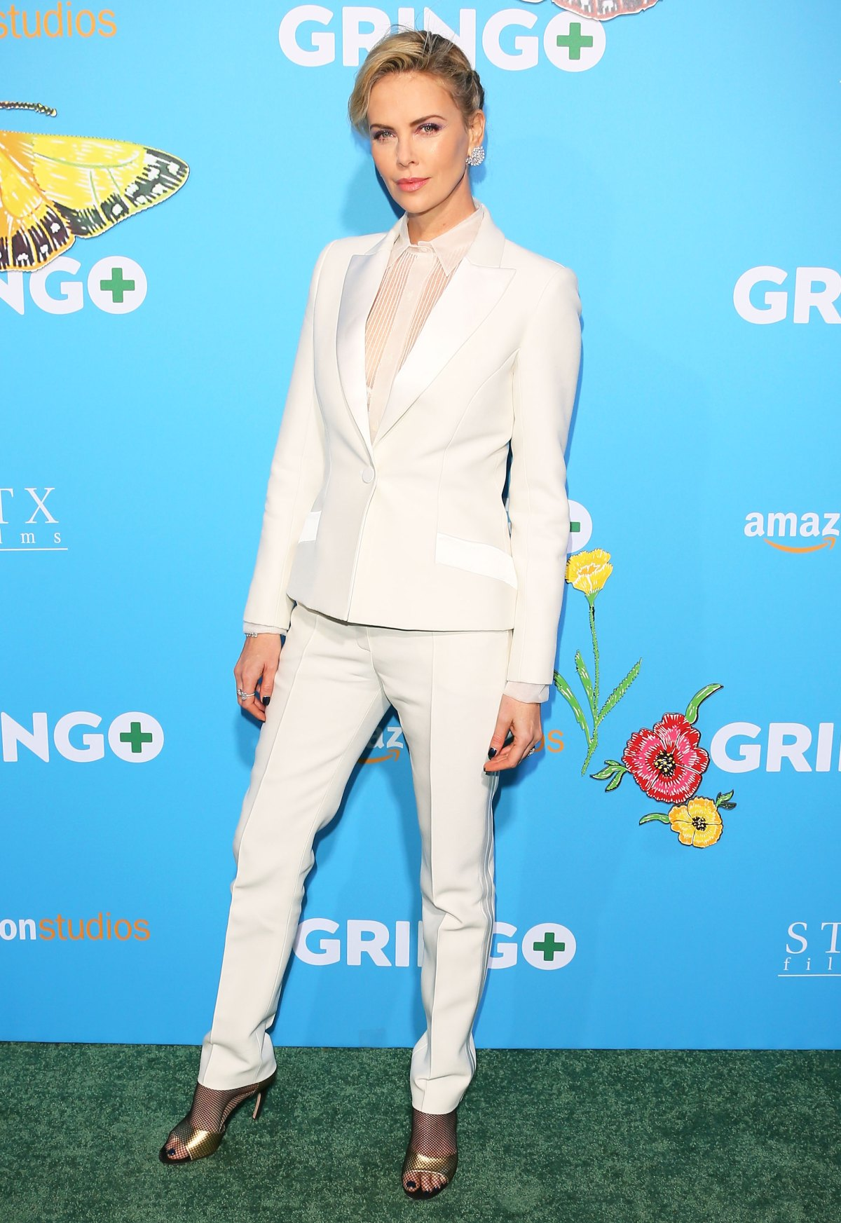 See Which Female Stars Traded In Their Red Carpet Dresses For Suits