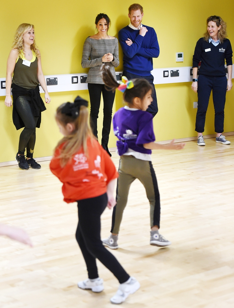 Prince Harry and Meghan Markle observes kids dancing