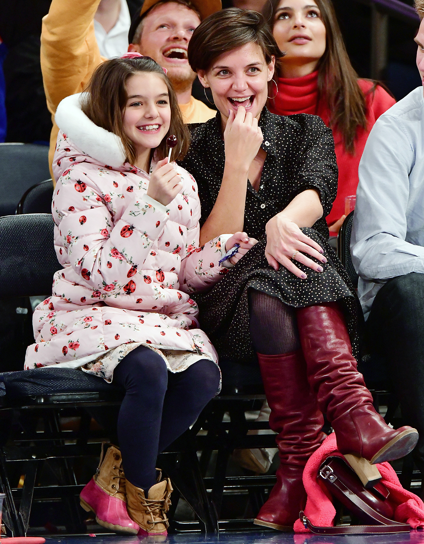 Suri Cruise and Katie Holmes attend the Oklahoma City Thunder Vs New York Knicks game