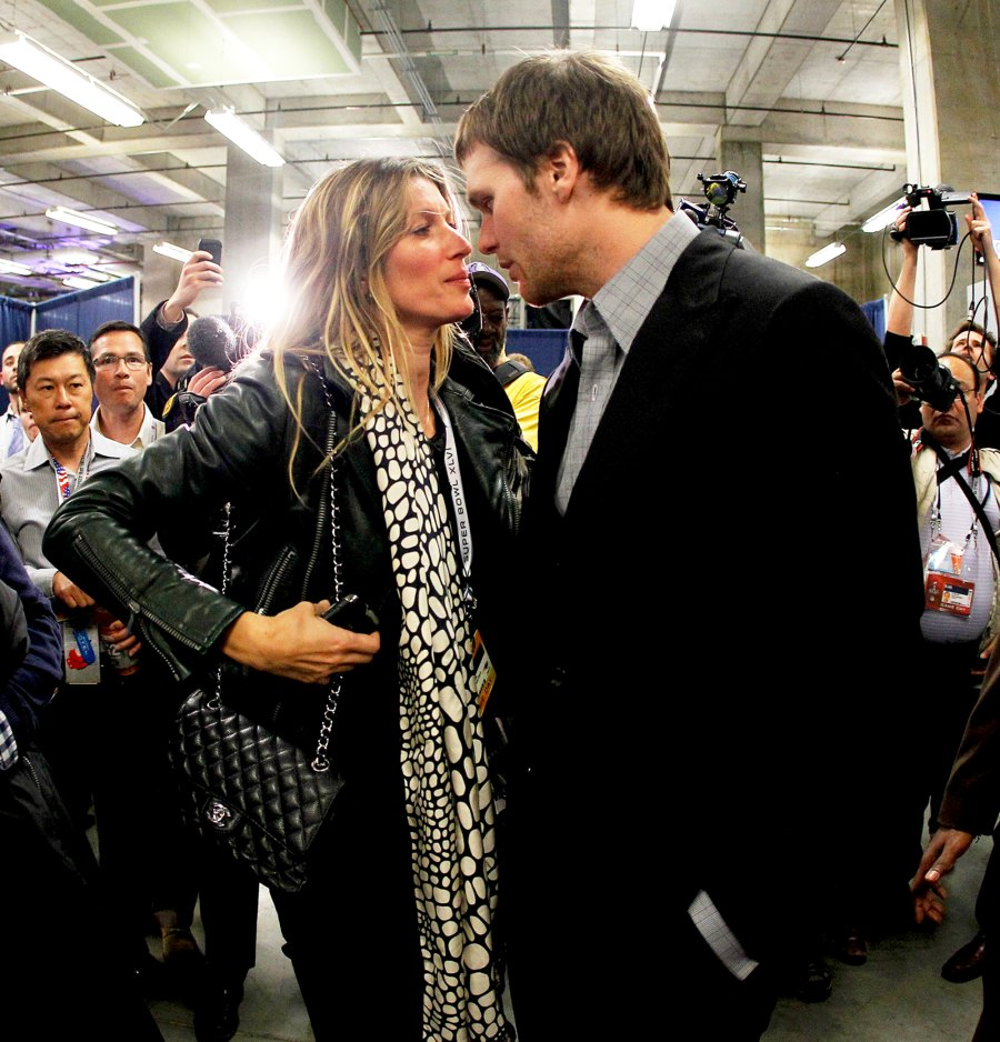Tom Brady #12 of the New England Patriots chats with his wife Gisele Bundchen during the Super Bowl XLVI at Lucas Oil Stadium in Indianapolis, Indiana.