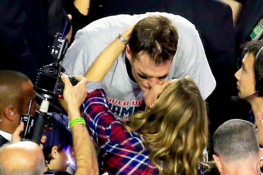 Tom Brady #12 of the New England Patriots kisses his wife Gisele Bundchen after defeating the Seattle Seahawks during Super Bowl XLIX at University of Phoenix Stadium on February 1, 2015 in Glendale, Arizona.