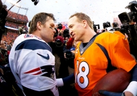 Peyton Manning #18 of the Denver Broncos and Tom Brady #12 of the New England Patriots during the 2016 AFC Championship game at Sports Authority Field at Mile High in Denver, Colorado.