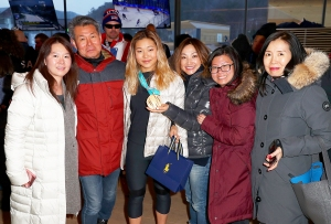 U.S. Olympian Chloe Kim poses with her family at the USA House at the PyeongChang 2018 Winter Olympic Games on February 14, 2018 in Pyeongchang-gun, South Korea.
