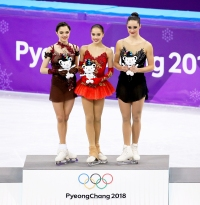 Silver medalist Evgenia Medvedeva of Olympic Athlete from Russia, gold medalist Alina Zagitova of Olympic Athlete from Russia, bronze medalist Kaetlyn Osmond of Canada during the venue victory ceremony following the Figure Skating Ladies Free program on day fourteen of the PyeongChang 2018 Winter Olympic Games at Gangneung Ice Arena on February 23, 2018 in Gangneung, South Korea.