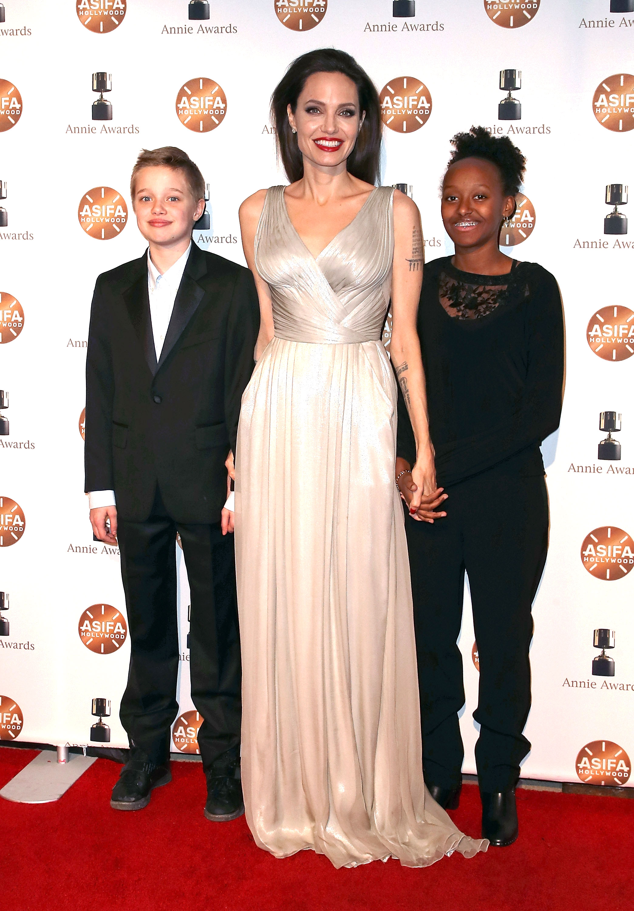 Angelina Jolie - The Oscar-winning actress took Shiloh (L) and Zahara as her dates to the 45th Annual Annie Awards in L.A. on February 3, 2018. Jolie was dressed in a floor-length silver gown, while Shiloh opted for a black suit and Zahara wore a black lace top and black pants.