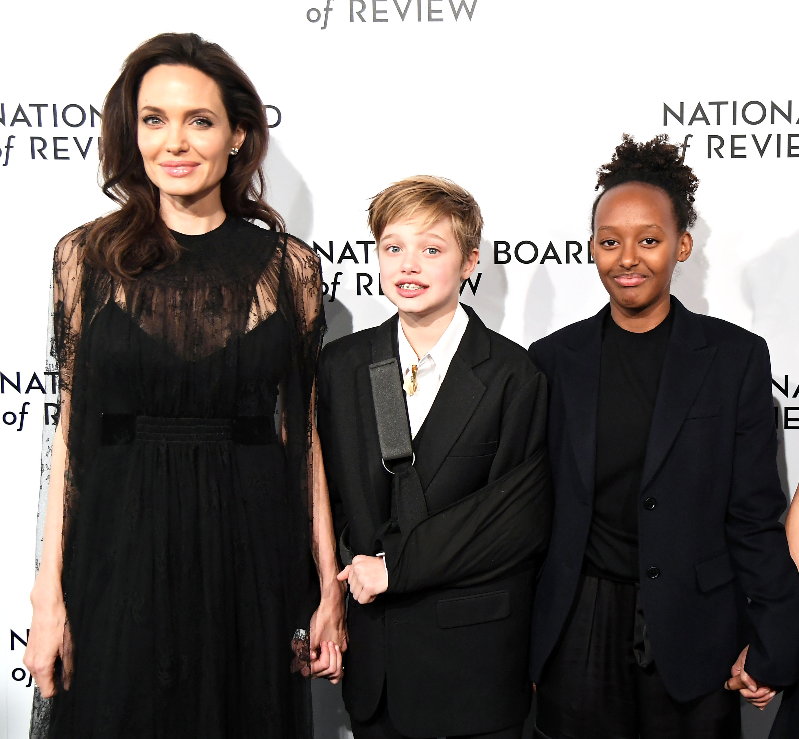 Angelina Jolie - Jolie attended the National Board of Review Awards Gala with two of her babes, Shiloh and Zahara. The trio matched in all black ensembles at the event which took place in NYC on January 8, 2018.