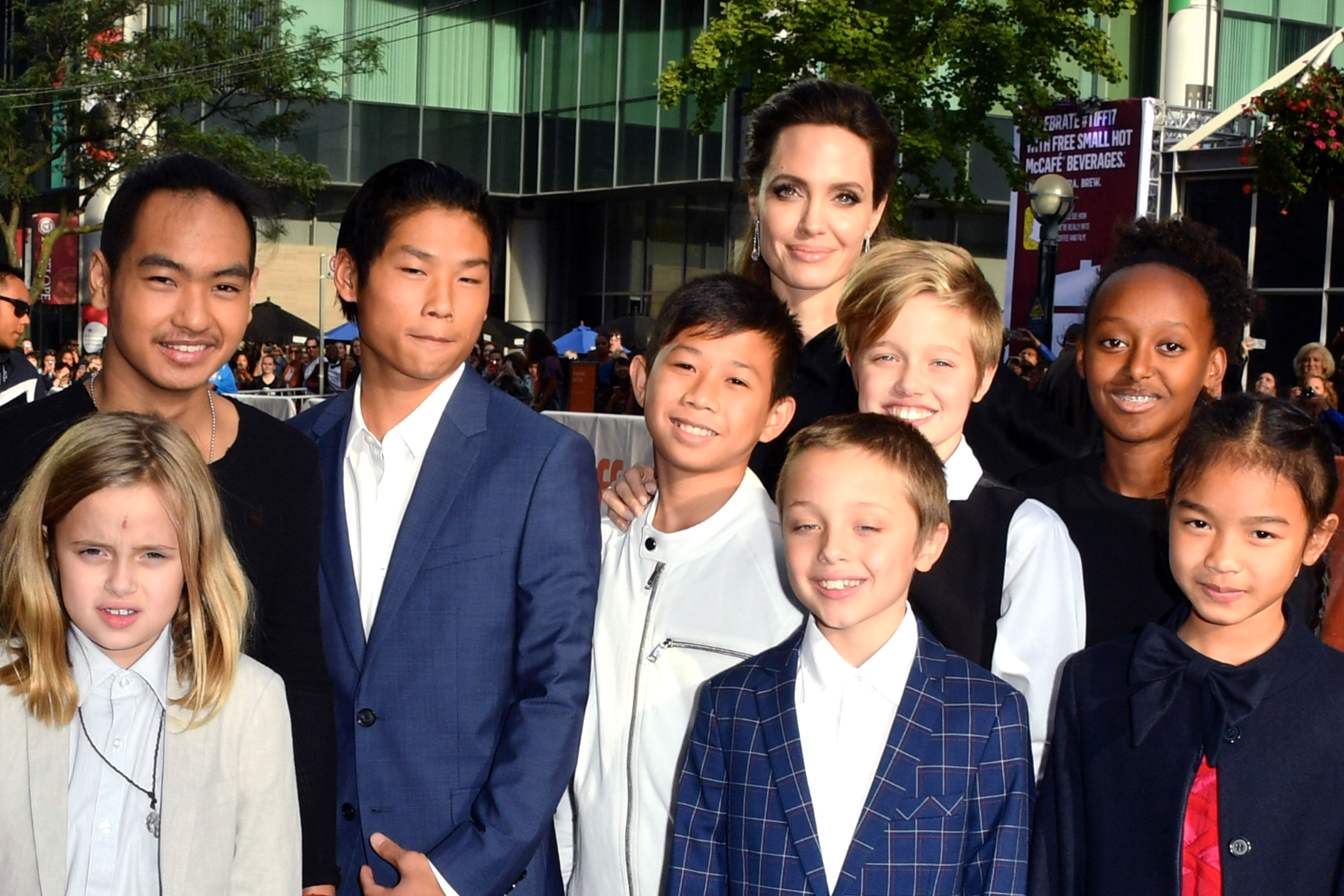 "Angelina Jolie - TORONTO, ON – SEPTEMBER 11: Vivienne Jolie-Pitt, Maddox Jolie-Pitt, Pax Jolie-Pitt, Kimhak Mun, Knox Jolie-Pitt, Shiloh Jolie-Pitt, Angelina Jolie, Zahara Jolie-Pitt and Sareum Srey Moch attend 2017 Toronto International Film Festival – ""First They Killed My Father"" Premiere at Princess of Wales Theatre on September 11, 2017 in Toronto, Canada. (Photo by George Pimentel/WireImage)"