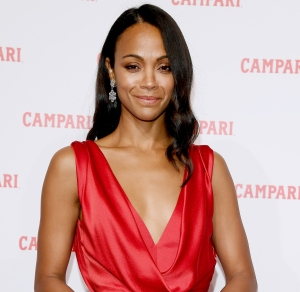 Zoe Saldana Attends The Premiere For The Campari Red Diaries Short Movie The Legend Of Red Hand Wearing Dress By Alberta Ferretti Earrings By Buccellati