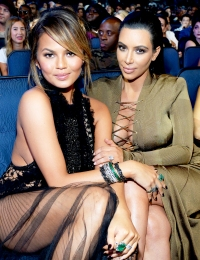 Chrissy Teigen and Kim Kardashian attend the 2015 MTV Video Music Awards at Microsoft Theater in Los Angeles, California.