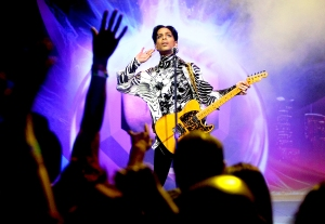 Prince performs on stage during 'One Night... Three Venues' at Nokia Theatre L.A. Live in Los Angeles in 2009.