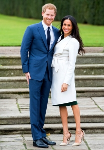 Prince Harry and Meghan Markle during an official photocall to announce their engagement at The Sunken Gardens at Kensington Palace on November 27, 2017 in London, England.