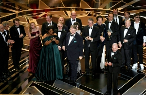 "Mexican director Guillermo del Toro stands on stage with his cast and crew after he won the Oscar for Best Film for ""The Shape of Water"" during the 90th Annual Academy Awards show on March 4, 2018 in Hollywood, California."