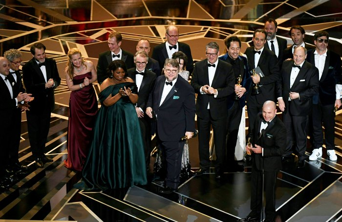 """Mexican director Guillermo del Toro stands on stage with his cast and crew after he won the Oscar for Best Film for """"The Shape of Water"""" during the 90th Annual Academy Awards show on March 4, 2018 in Hollywood, California."""
