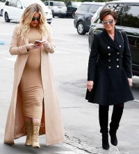 Khloe Kardashian Shows Off Baby Bump in Tight Dress