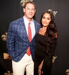 John Cena and Nikki Bella attend the 2017 MTV Movie And TV Awards at The Shrine Auditorium in Los Angeles, California.