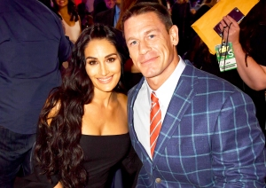 Nikki Bella and John Cena attend the 2017 MTV Movie And TV Awards at The Shrine Auditorium in Los Angeles, California.