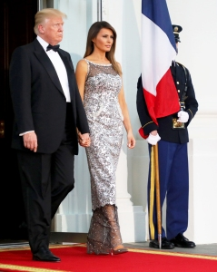 Donald Trump and Melania Trump arrive to welcome French President Emmanuel Macron and his wife, Brigitte Macron for a State Dinner at the North Portico of the White House in Washington, DC April 24, 2018.