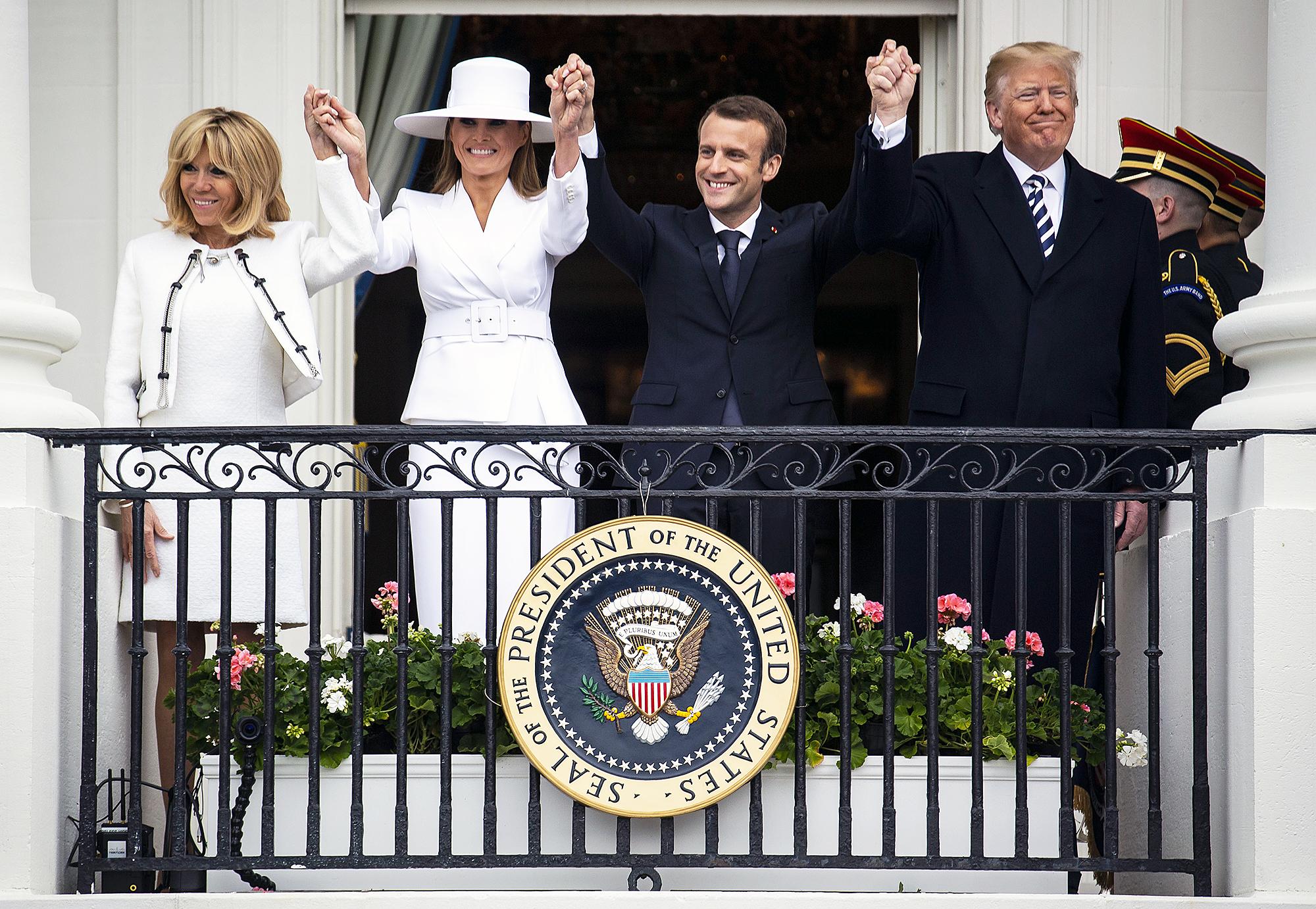 Brigitte Macron Melania Trump Emmanuel Macron Donald Trump holding hands