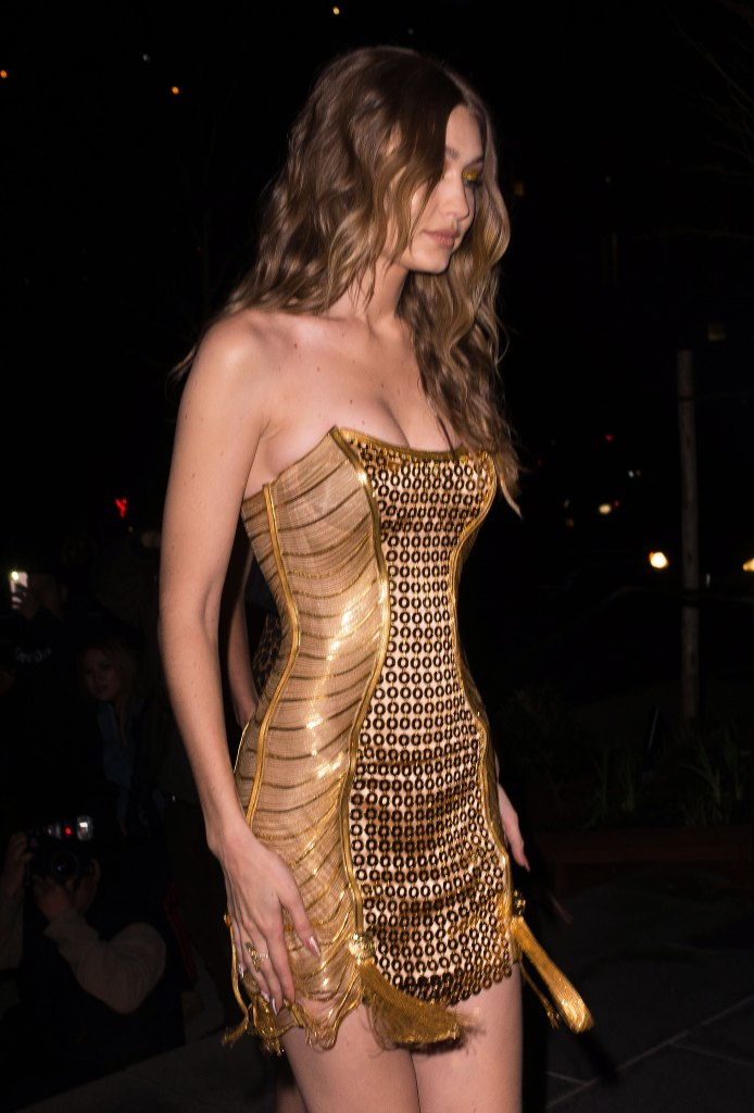 gigi hadid wears gold versace minidress to celebrate 23rd birthday. Black Bedroom Furniture Sets. Home Design Ideas