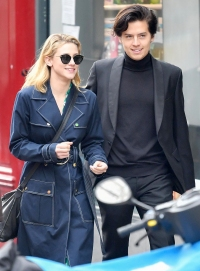 Lili-Reinhart-and-Cole-Sprouse-Share-a-Kiss-in-Paris