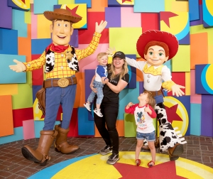 Kelly Clarkson and her children, Remy and River visit with Pixar pals Woody and Jessie at the launch of Pixar Fest at the Disneyland Resort in Anaheim, California.