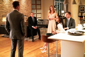 Rick Hoffman as Louis Litt, Sarah Rafferty as Donna Paulsen, Meghan Markle as Rachel Zane and Patrick J. Adams as Mike Ross in 'Suits'