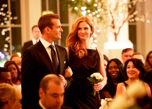 Gabriel Macht as Harvey Specter and Sarah Rafferty as Donna Paulsen in 'Suits'